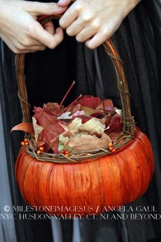 """Instead of a flower girl, have a """"leaf girl"""" for autumn weddings! The pumpkin basket goes with this wedding's Halloween theme."""