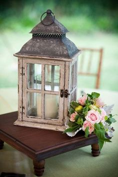 candle in lantern, with flower decoration