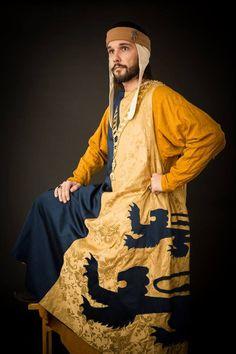1st half of 14th century, heraldic surcote made of batist and brocade, tunic is made of silk, woolen cap