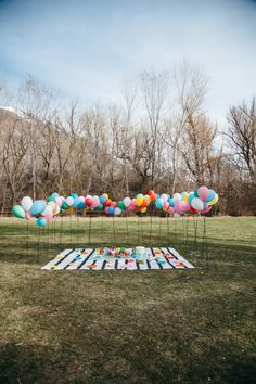 Although this outdoor balloon scene is intended as a baby shower, I think it would also make an amazing birthday or anniversary surprise picnic, or even kid's garden party. Click to see more beautiful pictures.