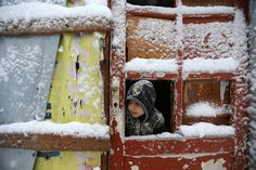 Deir Zannoun, Lebanon A Syrian boy looks out through his tent door covered in snow at a refugee camp in Deir Zannoun, Lebanon, on Jan. Best weather pictures of the week Syrian Refugees In Lebanon, Syrian Refugee Camps, Children Of Syria, Poor Children, Refugee Crisis, Winter Storm, Pictures Of The Week, New Mums, Little People