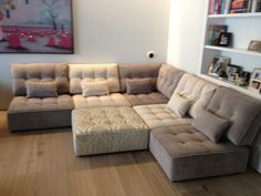 Grown up open plan space with flexible modules.  This sofa arrangement is made up of a corner, 4 armless and large footstool modules.