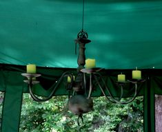 Having recently received a gazebo tent, I was determined to transform it into an outdoor room, complete with an outdoor chandelier. I'd seen them at Pottery Barn and at Lowe's, but didn… Gazebo Chandelier, Gazebo Lighting, Candle Chandelier, Chandelier Lighting, Chandeliers, Chandelier Ideas, White Gazebo, Classic Candles, Home Lighting Design