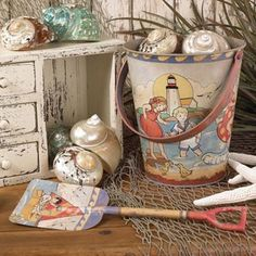 This metal sand pail and matching shovel is a reproduction of the vintage beach toys.