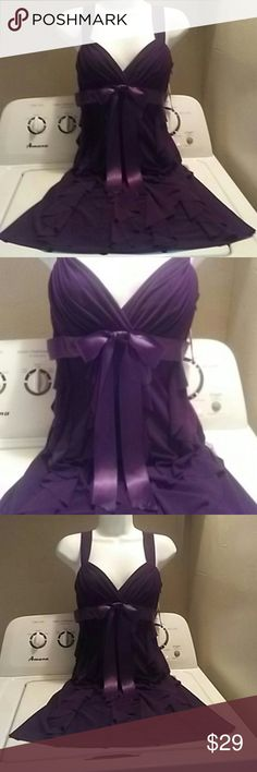 Beautiful Betsey & Adam cascading curls Gorgeous dark purple with a satin bow . I paid 265.00 and never got to wear it. The material falls is waves in the back and the front is finished off with a beautiful satin bow. If your familiar with the brand then you know the gorgeous quality dress this is can model if interested in purchasing.  2P true size Betsy & Adam Dresses Mini