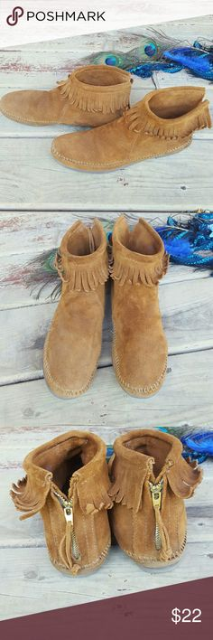 Boho Minnetonka fringe booties EUC size 8 Vintage Festival ready Minnetonka fringe booties. Size 8, very gently used. Vintage. Zipper closure until the back. Brown suade in fantastic condition.I ship same day when possible. Thank you!! Minnetonka Shoes Ankle Boots & Booties