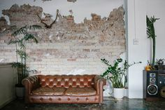 """I love this partial exposed brick look.....it has a name, something like """"the Baghdad look"""" or something that alludes to a bomb blast....."""