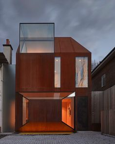 The design for this corten steel house in West London has received a merit at the Structural Steel Design Awards. The rust-like appearance of the weathered corten steel cladding is a striking feature of the cutting-edge design of this private dwelling.