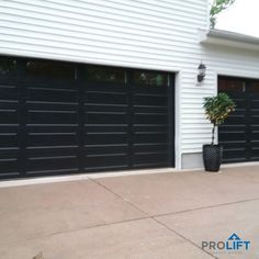 The hallmark features of midcentury modern and contemporary garage doors are clean, sleek lines and made from materials like steel, aluminum, glass or even wood. Some also describe the look as minimalist. Here's what you need to know.... | Why Homeowners Choose Mid Century Modern and Contemporary Garage Doors by ProLift Garage Doors of St. Louis Blog | Black Garage Doors, Garage Door Colors, Custom Garage Doors, Garage Door Windows, Garage Door Design, Contemporary Garage Doors, Modern Garage Doors, Prado, Garage Door Installation