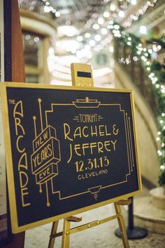 Art Deco wedding sign, photo by Suzuran Photography http://ruffledblog.com/new-years-eve-cleveland-wedding #weddingsign #signs #artdeco