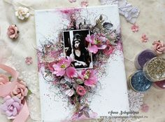 """""""Today, I would like to share a canvas about the English singer Amy Winehouse. I created this canvas with my favorite Prima Marketing flowers, paints and toppings."""""""