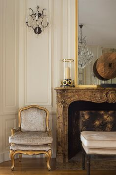 The French Louis XV Chauffeuse armchair found a perfect spot next to the fireplace in our Seine Riverfront project.
