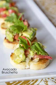 Avocado and Tomato Bruschetta Recipe ~ Says: It's so easy to make and sure to please a hungry crowd. It combines all the flavors you love about your favorite guacamole – creamy avocado, spicy onion, savory tomato, garlic, lime and cilantro – into a unique new dish