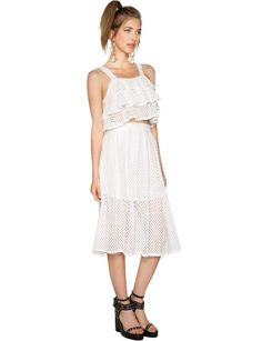 """Look no further for the ultimate summer matching set, with lace and ruffle and everything nice. This super cute white skirt set has a ruffled eyelet crop top, and a volume midi skirt with an elastic waist. Top is lined, skirt is partially lined. Both looks amazing together or styled separately, just add high heels. * Cotton polyester blend*32""""/81cm bust, 16""""/41cm top length ,26""""/66cm waist, 28""""/71cm skirt length*Model is wearing size small and model's height is 5'8.5""""/174cm."""