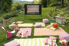 We're hosting an outdoor movie night, complete with dozens of decorating and snack ideas! Find out how to get the look of this outdoor party setup at home.