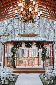 Charming Winter Wedding Decorations ★ winter wedding decorations the ceremony in the gazebo is decorated with lanterns of greenery with white flowers and light fabrics emily joanne wedding films and photography Gazebo Wedding Decorations, Wedding Wreaths, Gazebo Ideas, Wedding Flowers, Outdoor Winter Wedding, Outdoor Weddings, Winter Weddings, Outdoor Events, Romantic Weddings