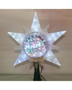 ce1365c15142 Kurt Adler The Early Years LED Lighted Star with Revolving Globe Chris from  Amazon.com
