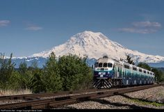 What a start to a predicted week of sunny dry weather in western Washington! With Mt. Rainier in full splendor, the first Northbound afternoon Sounder heads back to Seattle for another load of commuters. This train features one of Sound Transit's new MP36s.