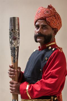 The Queen's Baton is held by an Indian hotel concierge, in Agra, India, at the start of the Asia leg of its journey of 70 Commonwealth natio...