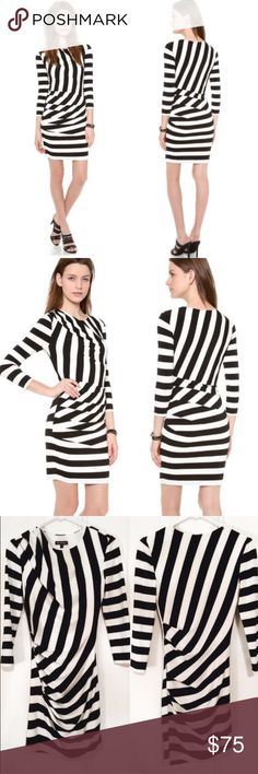 Juicy Couture Bold Striped Cocktail Dress Bold stripes bring graphic intensity to a body-con Juicy Couture cocktail dress. Side ruching casts elegant drape and creates a cowl effect at the neckline. Fitted long sleeves. Lined. Fabric: crepe. Fits true to size and looks exactly as it does in the professional photos. This dress is in perfect, like-new condition as it was worn only 2 times. Reasonable offers happily considered☺️ Juicy Couture Dresses Mini