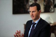 Russia's envoy to the UN on Friday warned long-term ally President Bashar al-Assad over his vow to retake all of Syria, saying he faced dire consequences i