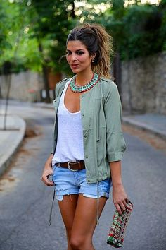 Green jacket , white Cami , shorts with pockets showing and brown belt ❤️