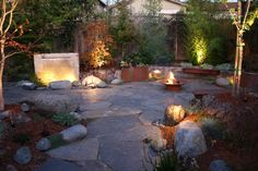 10 Pictures of Backyard Waterfalls for Your Exterior Design: Pictures Of Backyard Waterfalls With Bench Seating Also Exterior Lighting And Fire Feature With Wood Fence Designs Plus Flagstone Pavers For Asian Patio ~ franklester.com Exterior Design Inspiration