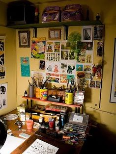 discovered this cute studio area on Bohemian Vintage ! love all the paint everywhere too.