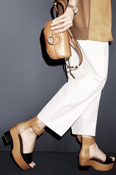 THE CROPPED PANT AND THE PLATFORM; Get a lift in the season's must-have shoe paired with these generously proportioned trousers that are spring-ready in white. Hermès cardigan, $4,900, pants, $1,475, bag, $8,050 and sandals, $990, 800-441-4488; Rolex watch, $31,200, rolex.com.    - HarpersBAZAAR.com