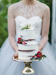 Gorgeous nearly naked cake with fruit and flowers