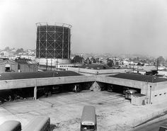 Ocean Park Bus Yard  circa 1951     Ocean Park Bus Yard formerly functioned as a rail yard, but was altered to suit Pacific Electric Railway Company's changes in service. The brick structure visible to the left and behind the Ocean Park Bus Yard is former Ocean Park Substation no. 40. The taller, metal structure is a natural gas holder.