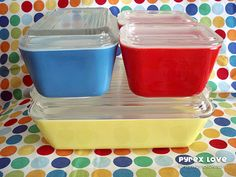 Vintage pyrex refrigerator dishes in primary colors.