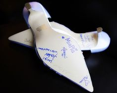 Something Blue....notes from the bridesmaids on the bottom of the bride's shoe. So sweet and makes a great keepsake!