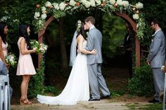 The most romantic of garden weddings in a David's Bridal strapless A-line wedding dress | Photo via WeddingWire