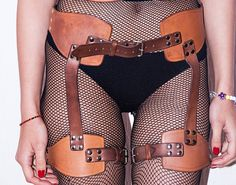 Check out this item in my Etsy shop https://www.etsy.com/listing/234995213/brown-leather-suspender-belt-bdsm