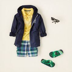a little nautical, very preppy! this fresh look features a navy blue zip-up, polo shirt and plaid cargo shorts. we finish it off with sunglasses and flip flops to give him a completely casual vibe #tcp #boysoutfit