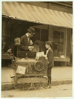 Joseph Severio - Peanut Vendor by Lewis Hine. he is 11 yrs old and has pushed the cart for 2 years. he works till after midnight. usually puts in 6 hours a day. works of own volition, all earnings go to father.