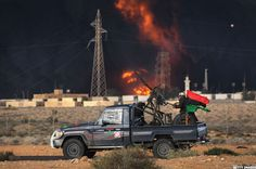 Libyan rebels attack government troops as a natural gas facility burns  near Ras Lanuf, Libya on March 9, 2011.