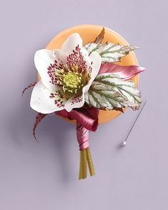 For more oomph, pair angel-wing begonia leaves with a hellebore bloom.  One-inch silk satin ribbon in Victorian rose