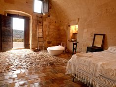 Experience a truly groundbreaking stay in one of the renovated and modernized cave hotels in the Sassi zone of Matera, Italy
