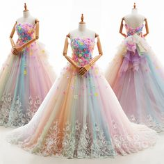 Pastel Rainbow See Through Wedding Dresses With Embroided Flower Details On The Top And An Ombre Effect To The Bottom. White And Colorful Ball Gown With Heart Shaped Neckline As An Inspiration For Prom.