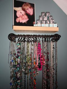 "34 Ideas How To Store Your Jewelry...Love this idea - Shower curtain hooks on a small rod; SO EASY to keep things untangeled and easy to find!   (USe curtain rod or towel rack and shower ""S"" hooks""  Love it!!"