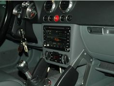 Custom double-DIN center console enclosure, fully finished and optional mounting hardware available: http://tt8n.de.
