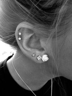 Five total piercings one flower earrings four diamond earrings.