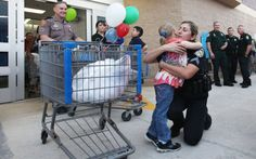 Shop with a Cop helps 150 kids shop for friends, family - w/photos #IndianRiverCounty