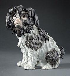 A Meissen Porcelain Bolognese Dog, 2nd half of the 19th century, Model by Johann Joachim Kandler around 1770. H. 22cm. Start price: 180 Euro