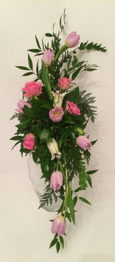 Classic Hogarth Curve floral arrangement - with tulips, lillies and roses…