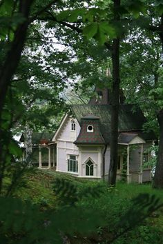 gorgeous vintage / Victorian cottage in a gorgeous, perfect setting. Love the windows. I would never want to leave home!