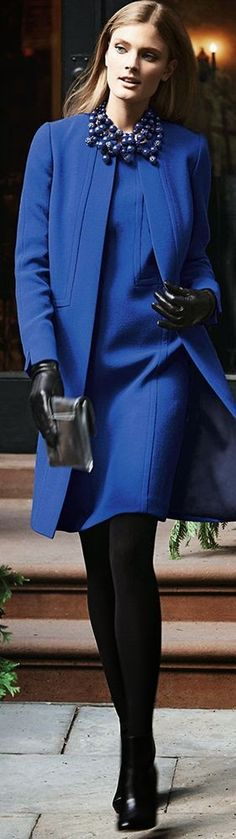 Women's fashion blue royal coat and dress with statement necklace