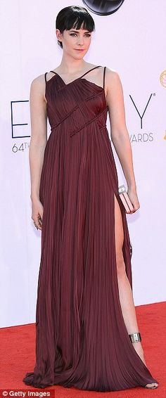 Jena Malone chose a burgundy J Mendel dress to wear at the #Emmys 2012. Click to view a clip of her talking with MTV about Catching Fire!